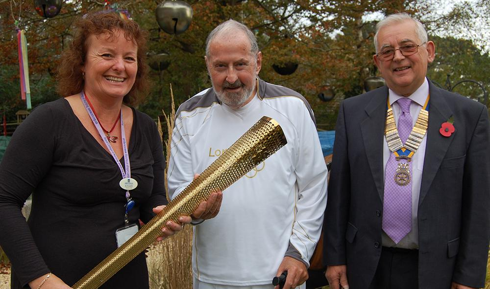 Mike carrying the Olympic torch